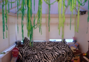 Crepe paper vines and my Dad's old zebra blanket (I knew we kept it for a reason)