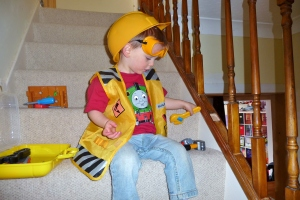My Bob Builder boy fixing the stairs (because Daddy hasn't!)