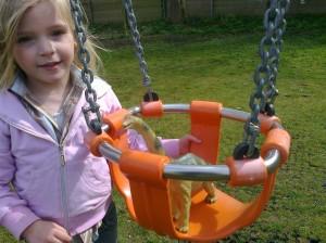 Pushing Dinosaur in the Swing