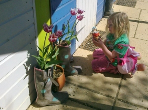 I'm Just looking at these gnomes and flowers Mummy