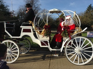 Father Christmas arriving by carriage