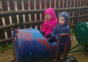 Braving the rain on the barrel train
