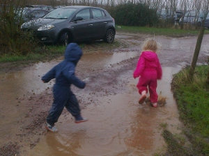 Jumping in Car Park Puddles