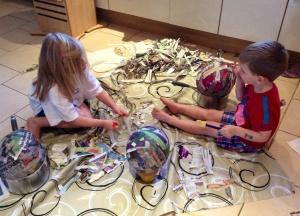 Making papier-mache balloons